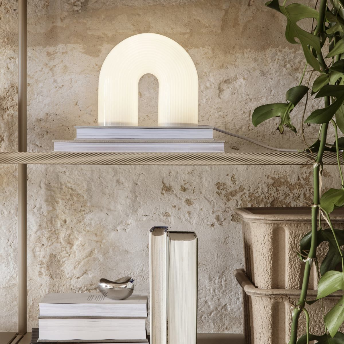 Ferm Living Vuelta Table Lamp on standing on book a shelf