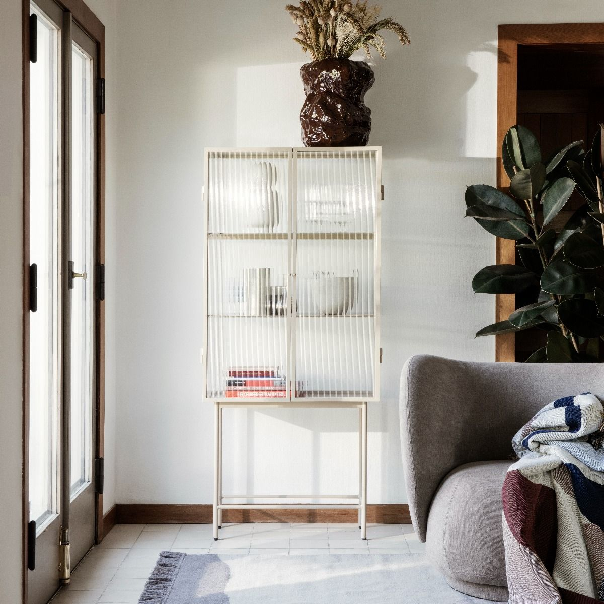 Ferm Living Haze Vitrine - Reeded Glass in cashmere by entrance way