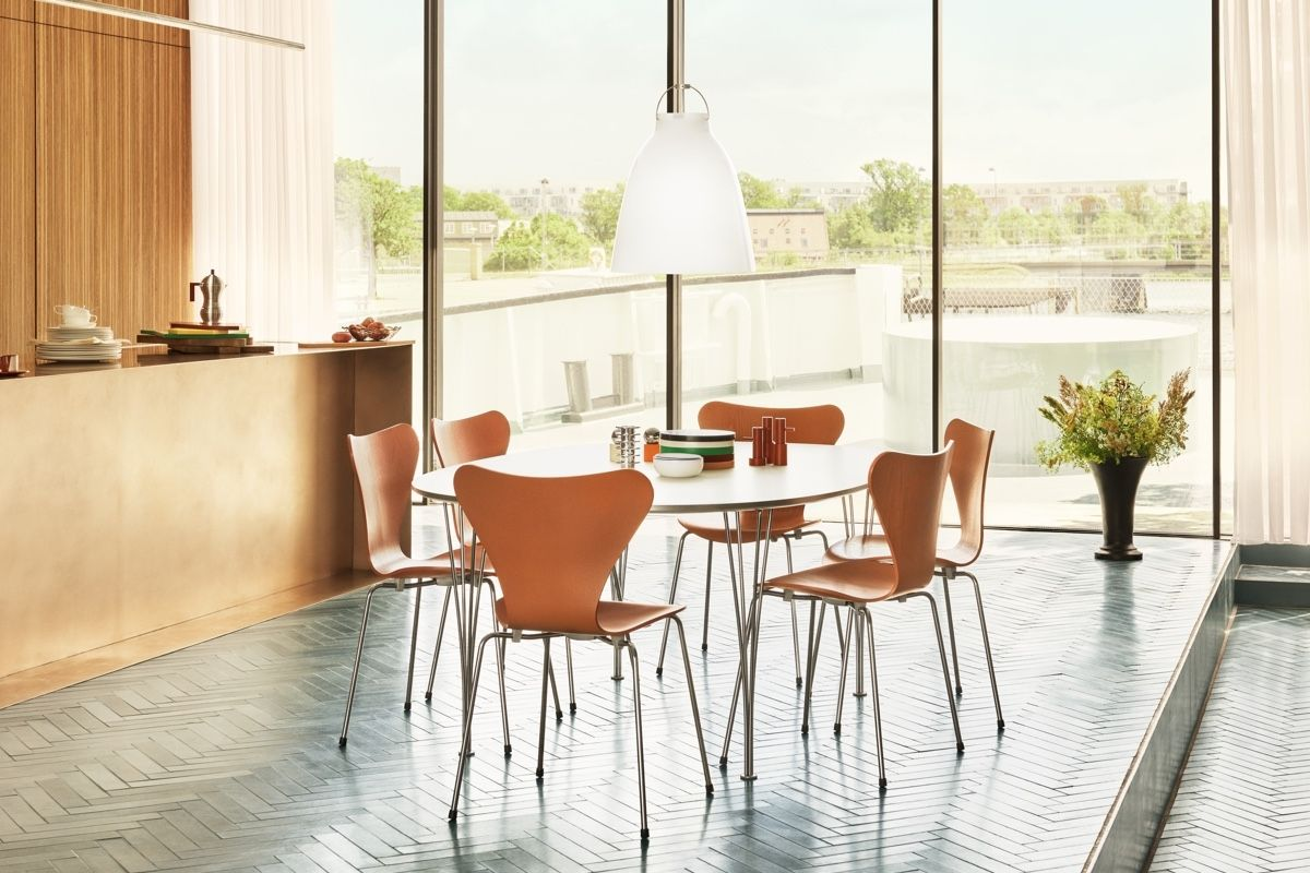 Fritz Hansen Series 7 Chair - Coloured Ash in kitchen dinner with Caravaggio pendant above the table