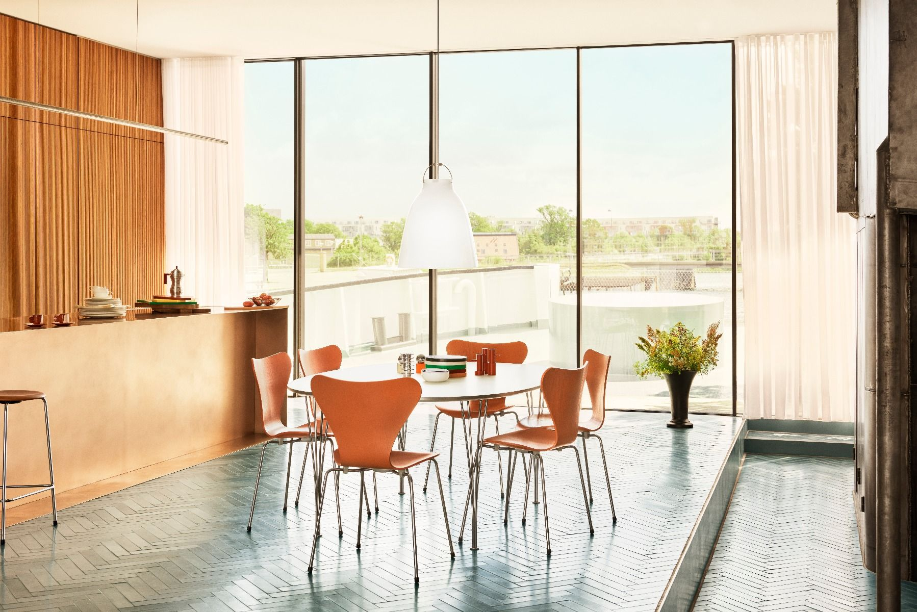 Fritz Hansen Caravaggio pendant light Opal in kitchen hanging over table