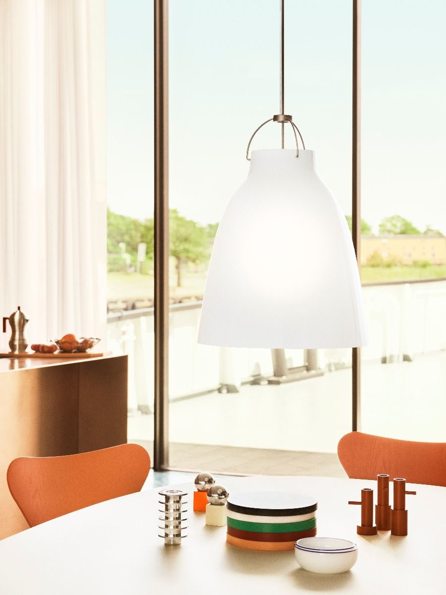 Fritz Hansen Caravaggio pendant light Opal p3 hanging over table