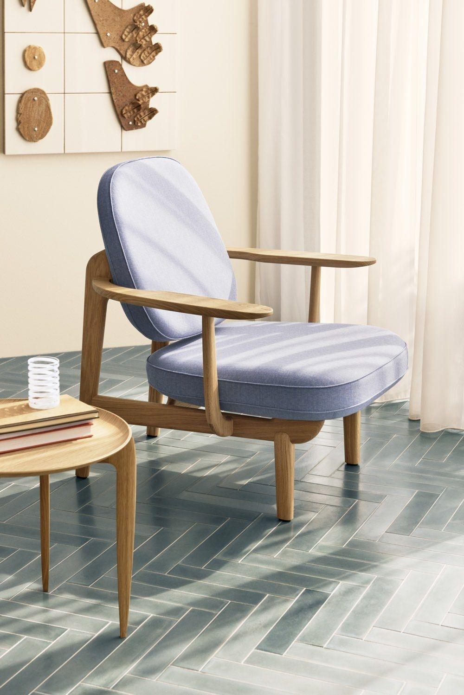 Fritz Hansen Fred Easy Chair in blue on a tiled floor