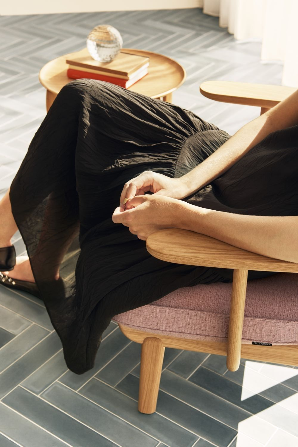 Fritz Hansen Fred Easy Chair with person sitting, arm detail