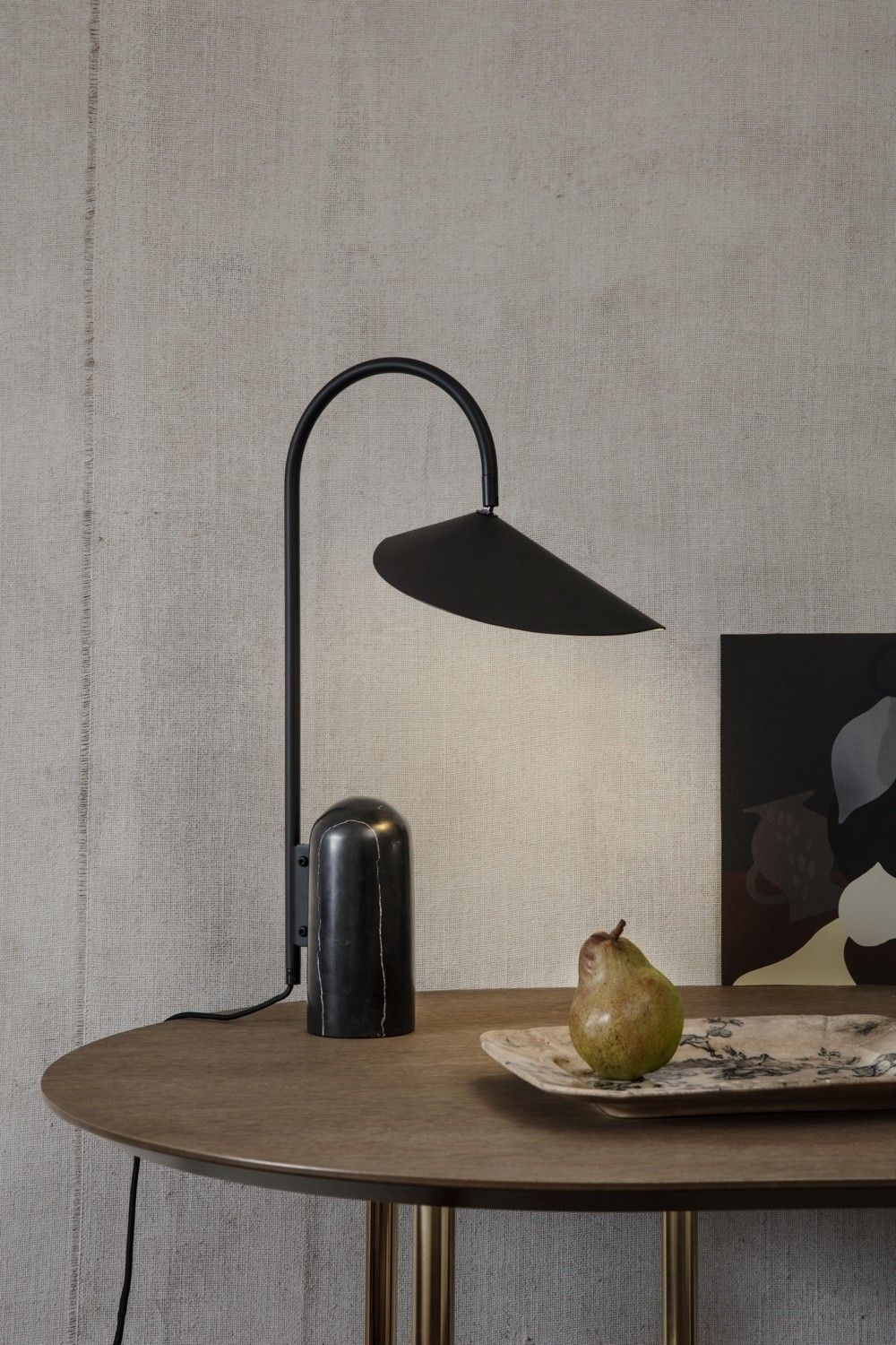 Ferm Living Arum Table Lamp black on a desk