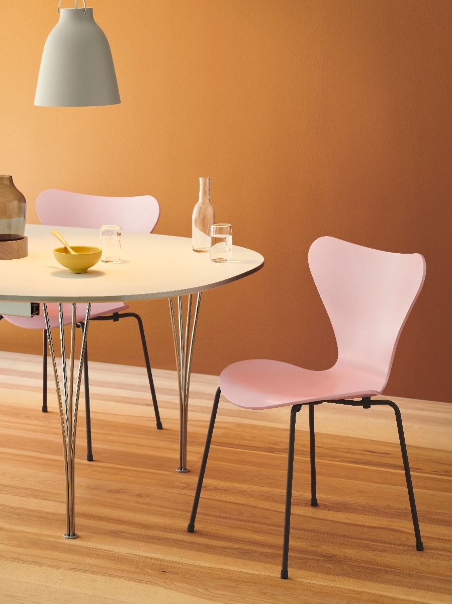 Fritz Hansen Series 7 Chair - Coloured Ash wild rose in dining room with orange wall