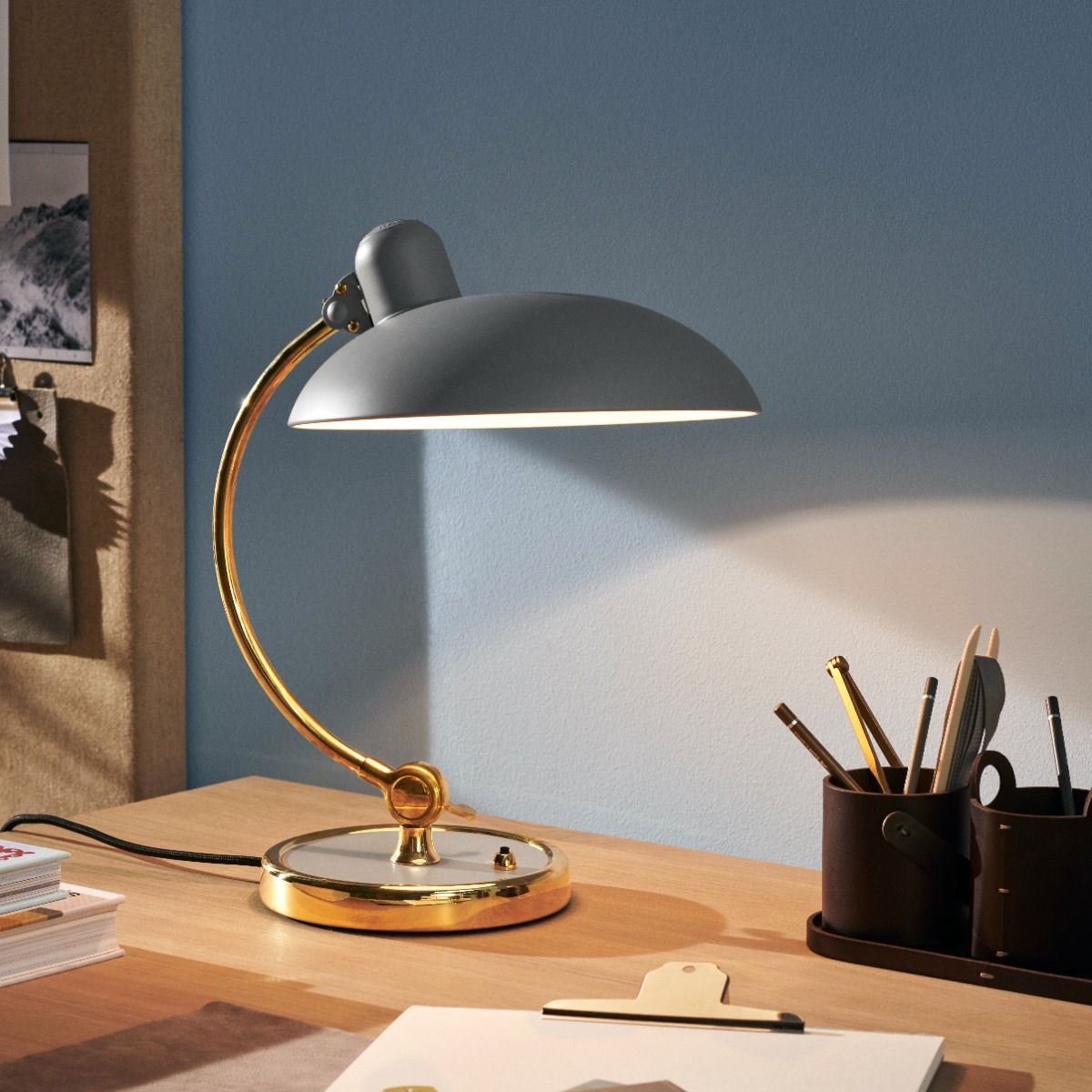Kaiser Idell6631-T Luxus in brass, and easy grey on a desk