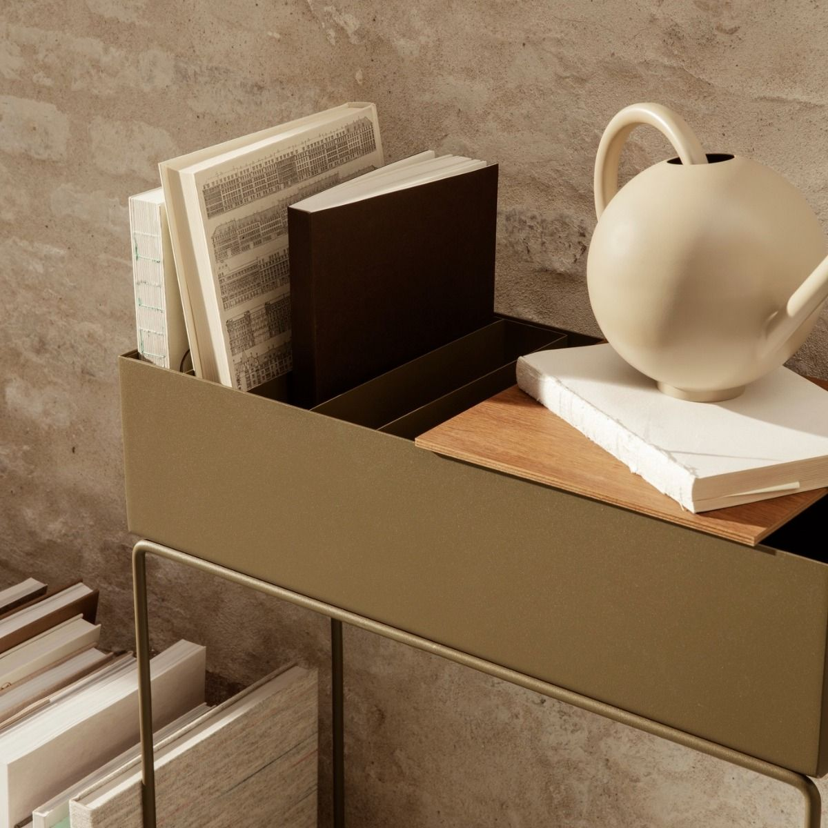 ferm living plant box with smoked lid being used as a book rack