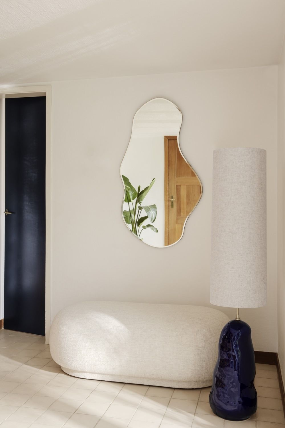 Ferm Living Pond Mirror Large hanging above a rico stool