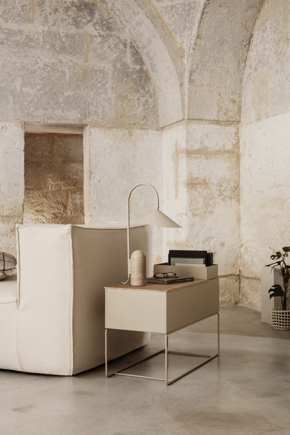 Ferm Living Arum Table Lamp cashmere in a sand stone interior next to sofa