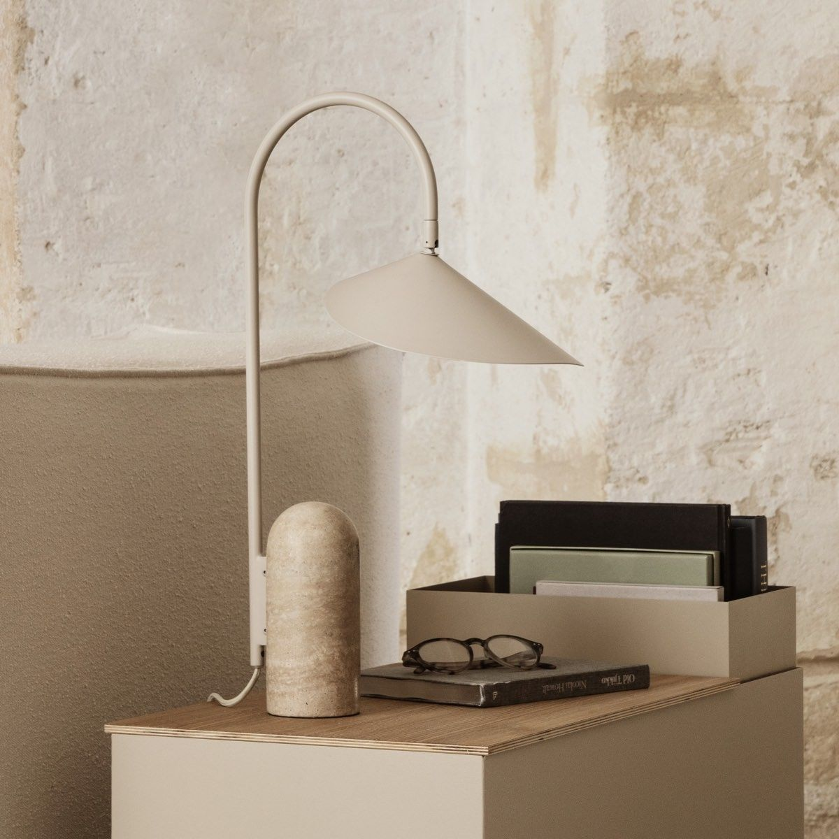 Ferm Living Arum Table Lamp Cashmere on a plant box next to sofa
