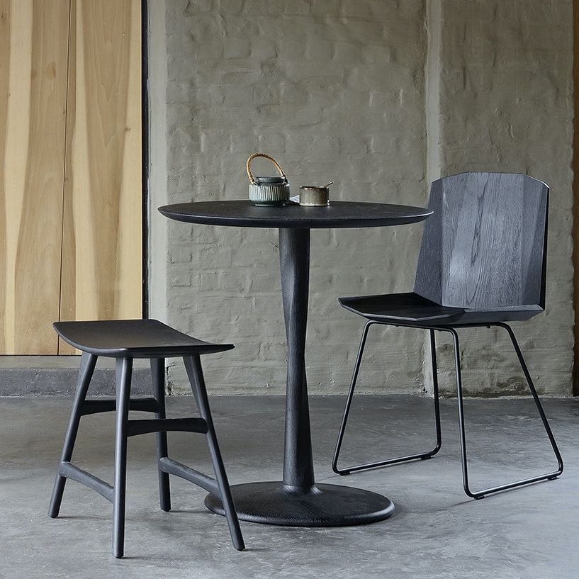 Ethnicraft Torsion Table in black varnish with the osso stool and facette chair