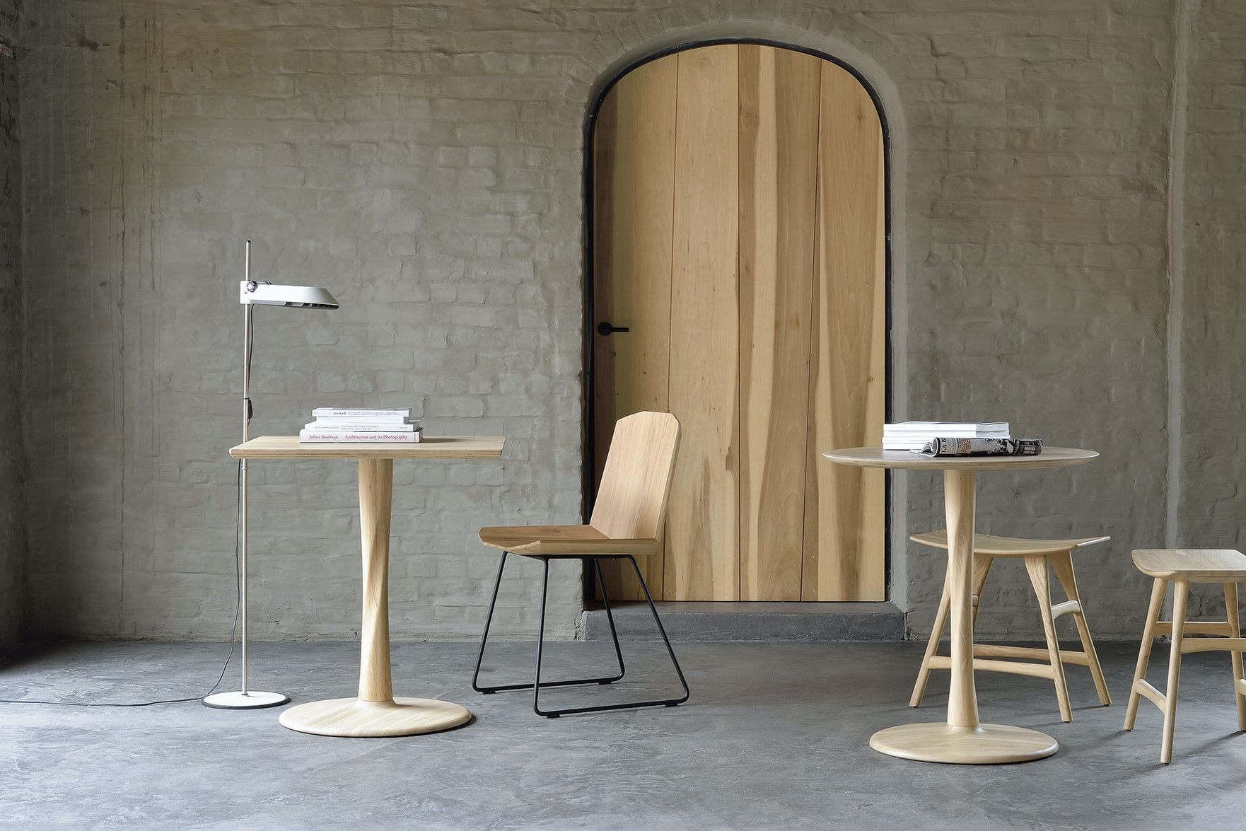 two Ethnicraft Torsion Tables in Oak with the facette chair and osso stools