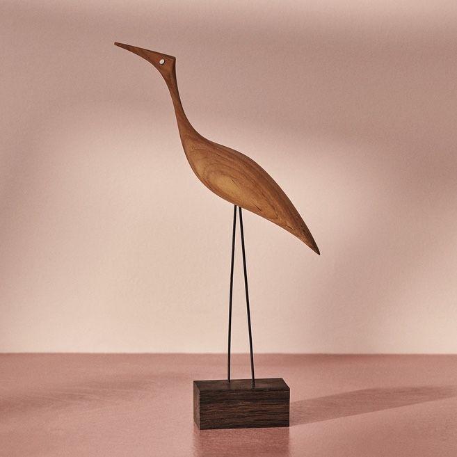Warm Nordic Beak Bird tall heron on a pink background