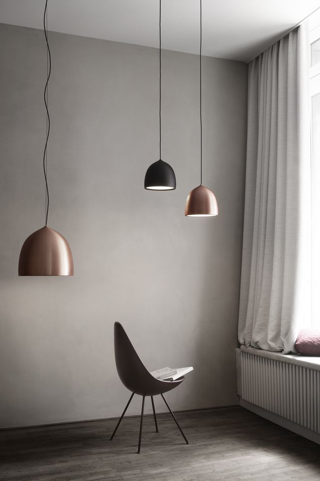 Fritz Hansen Suspence Copper Pendant Lights p1 and p2 hanging by a window