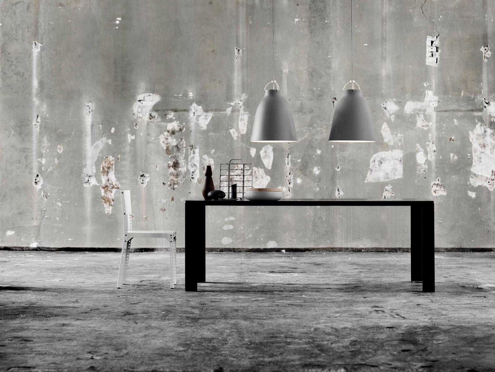 fritz hansen caravaggio pendant light matt grey hanging over black table