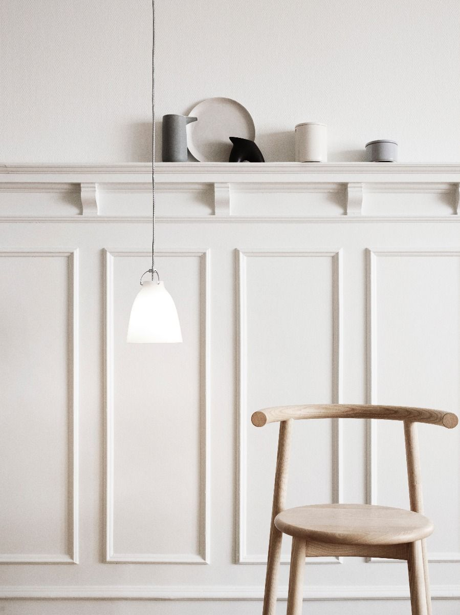 Fritz Hansen Caravaggio pendant light Opal hanging against panelled wall