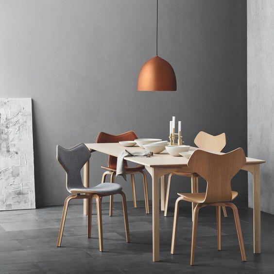 Fritz Hansen Suspence Copper Pendant Light above a table