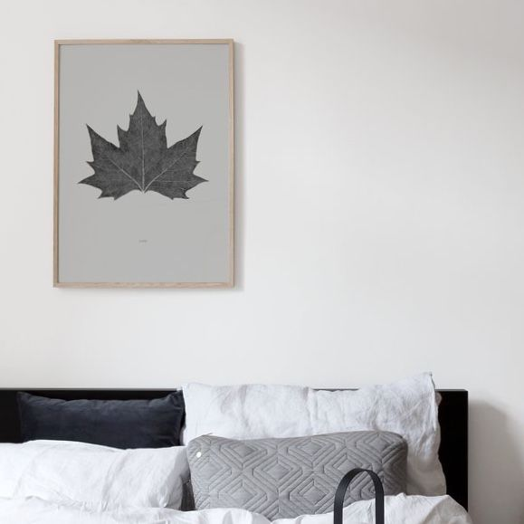 Coco Lapine La Feuille Poster in opak frame above bed