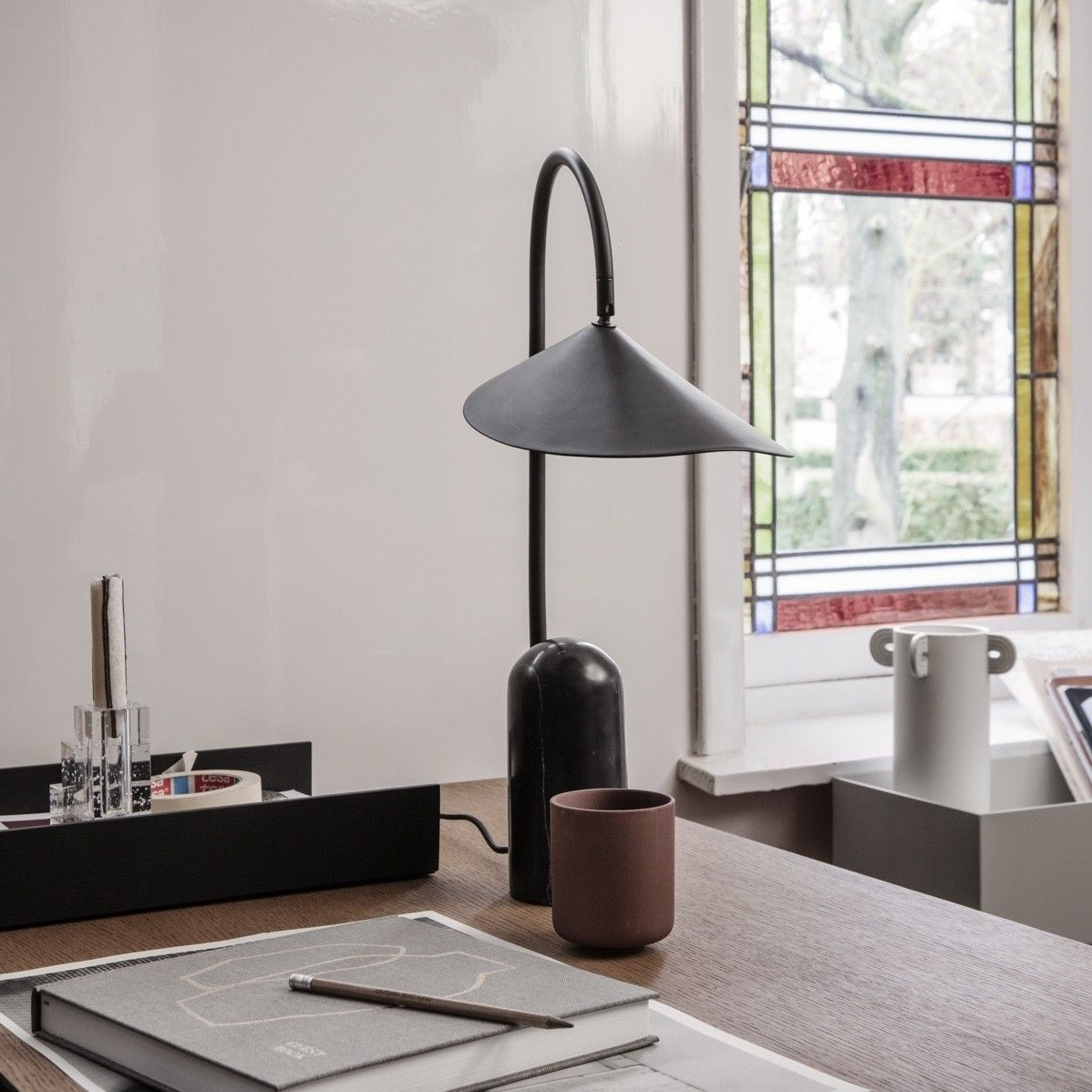 Ferm Living Arum Table Lamp in black on a walnut desk