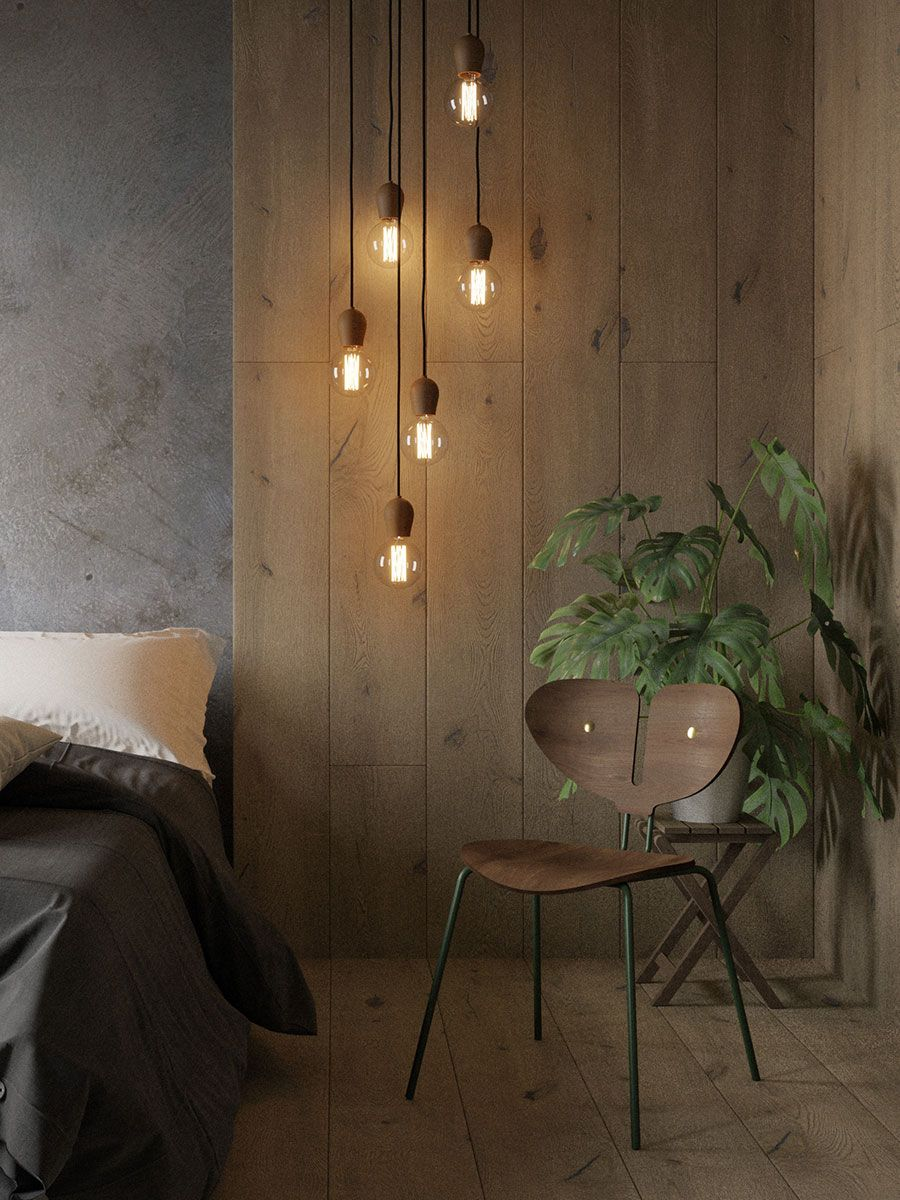 group of nordic takes bright sprout pendants hanging next to bed