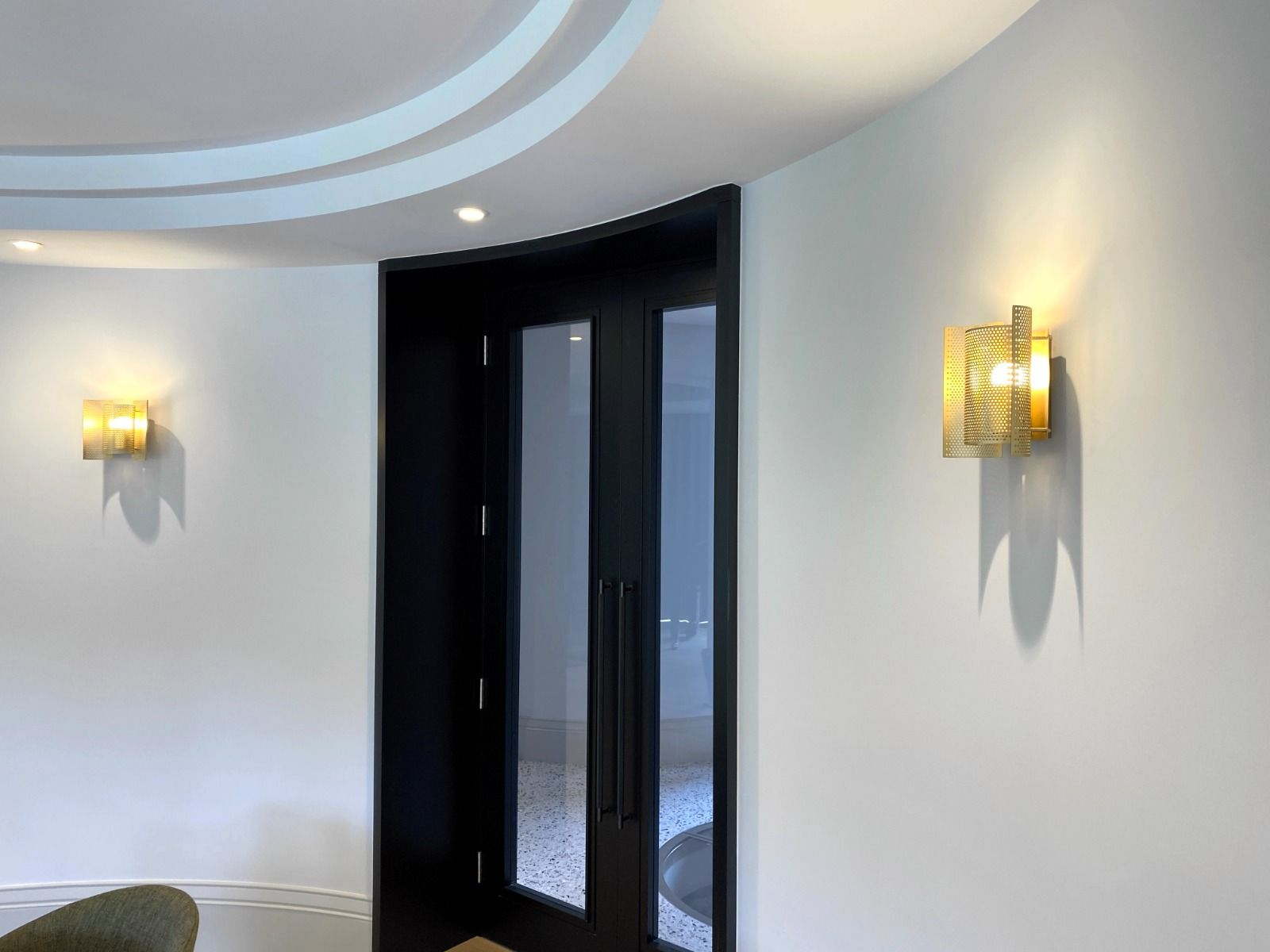 Northern Butterfly Wall Lights - Perforated - Brass - On - Fitted to a curved wall
