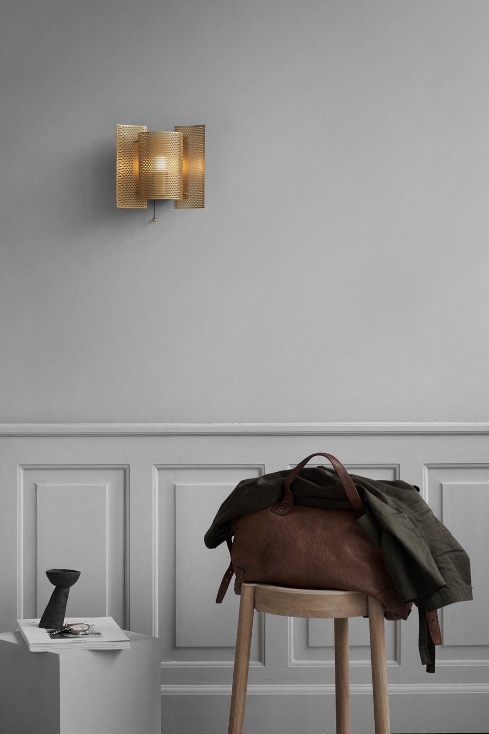 Northern Butterfly Wall Light - Perforated - Brass - On a wall above wall paneling