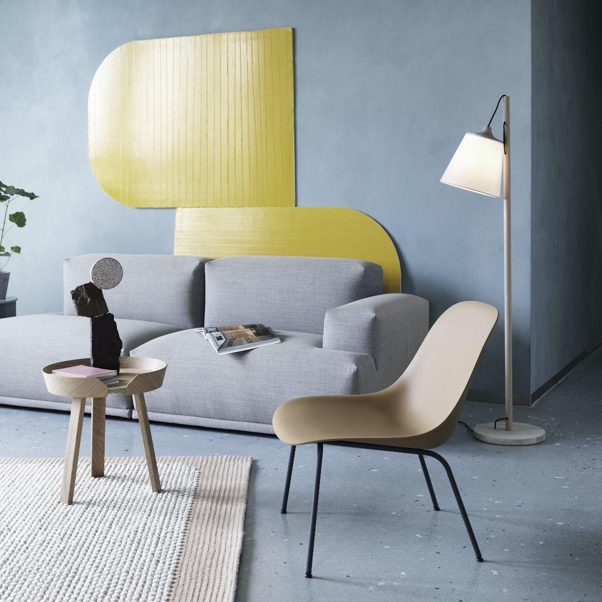 Muuto Pull Floor Lamp next to a grey sofa