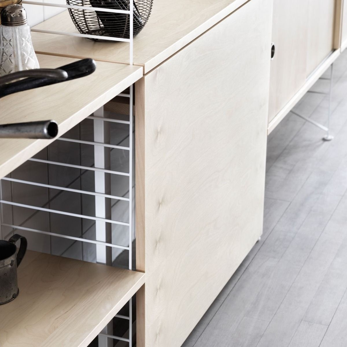 String shelving system for the kitchen in ash detail of table folded down