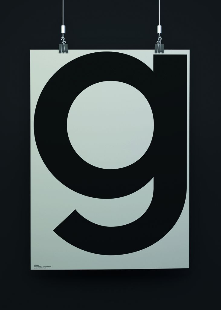 playtype grey g poster on a grey background suspended by hanging clips