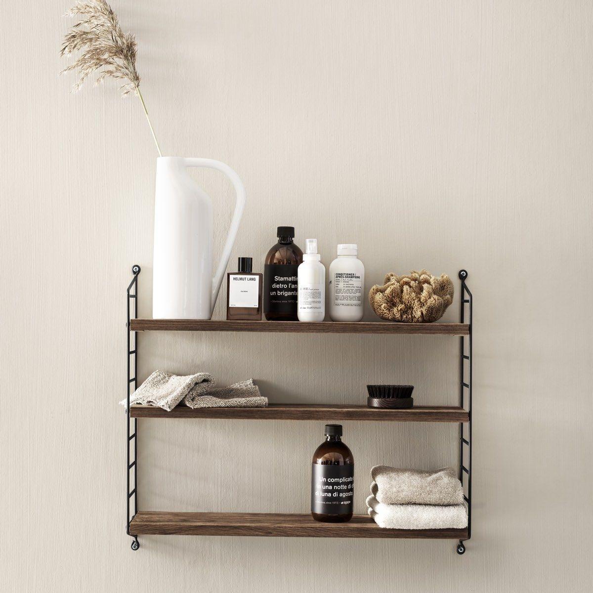 String Pocket Shelf walnut and black in bathroom