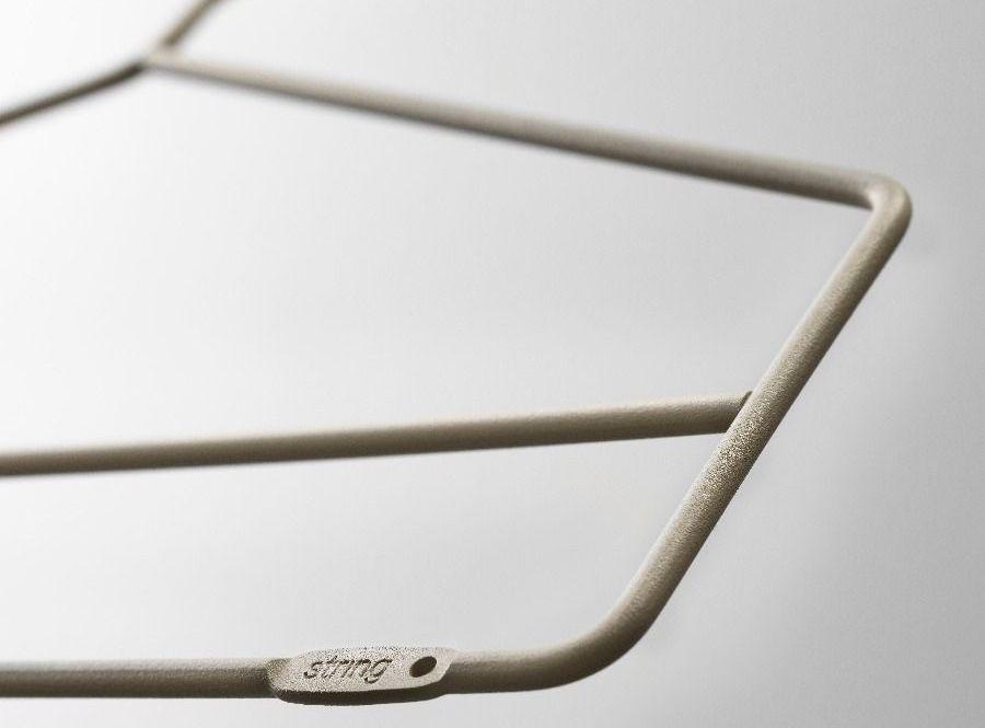 detail of beige string shelving coat hanger