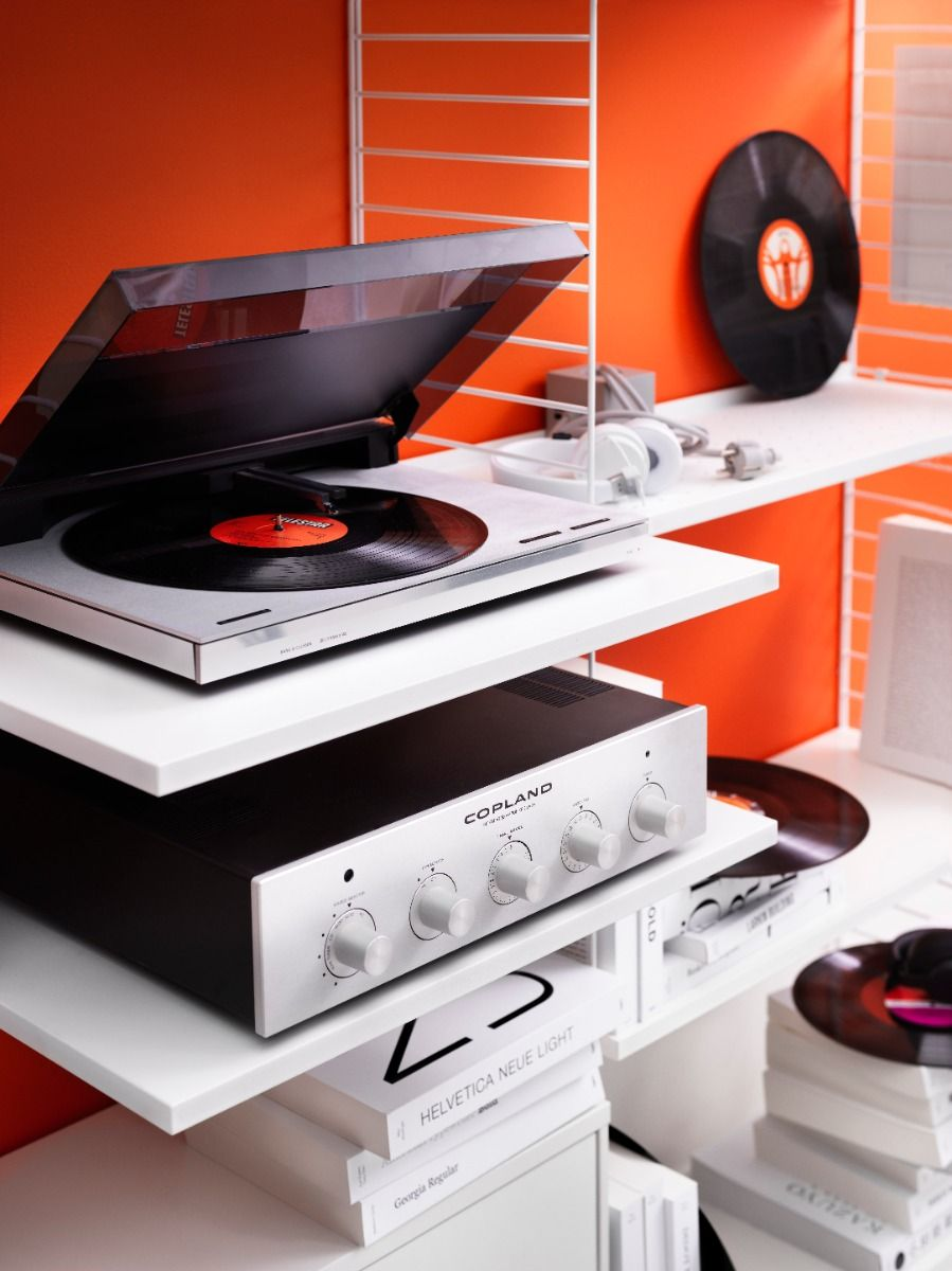 String shelving media shelf with record player and amp