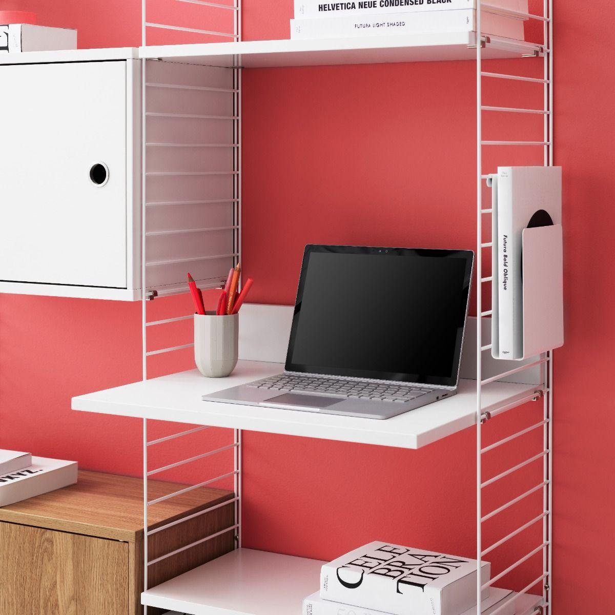 String shelving media shelf used as a desk