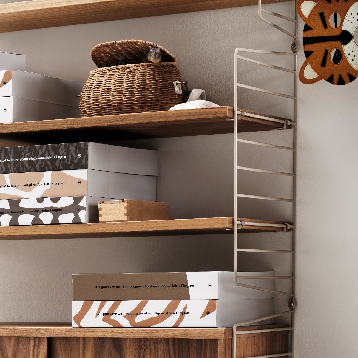 string shelving system with beige side panels and 78 x 30cm walnut shelves