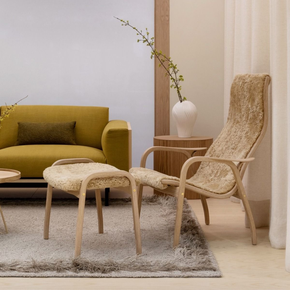 Swedese Lamino Easy Chair - Anniversary Edition next to a sofa