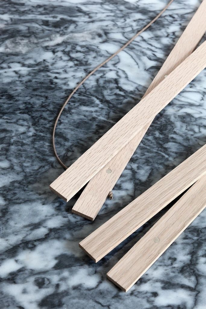 Coco Lapine oak wooden poster hanger, magnetic wooden slats on a marble table top