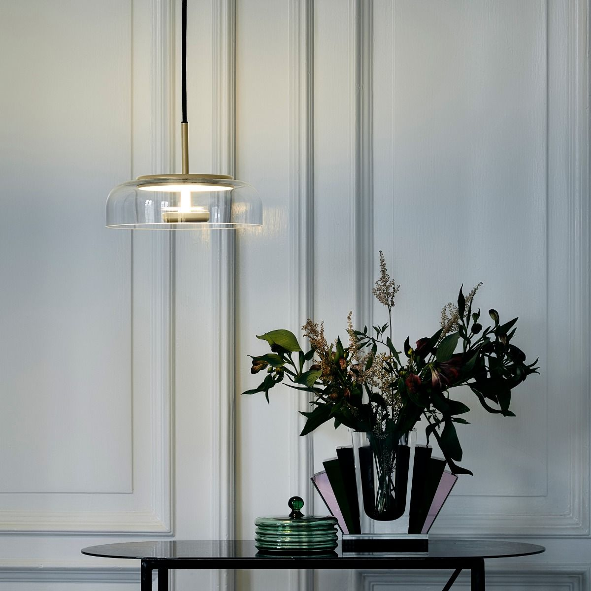 Blossi pendant light against wall paneling