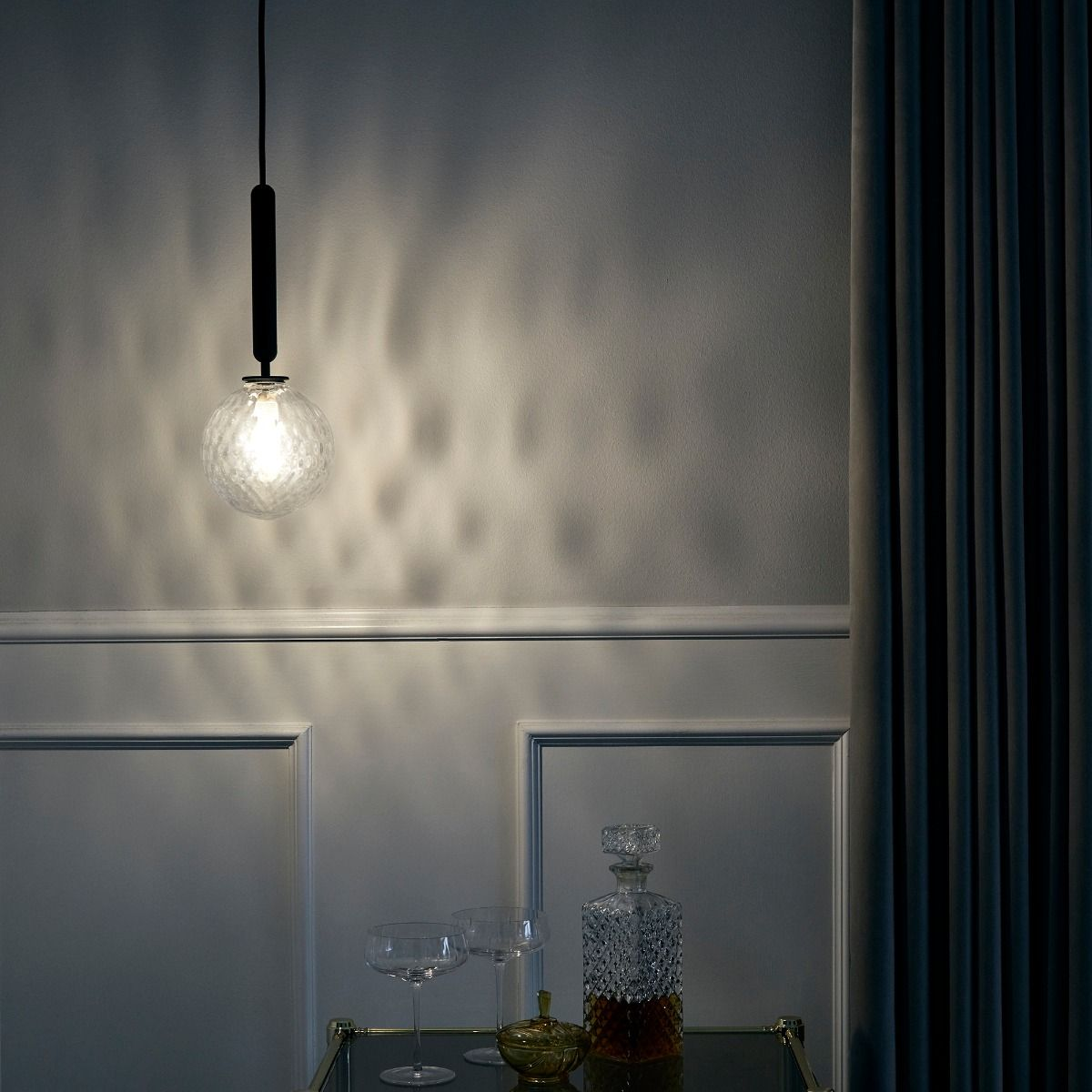 Nuura Lighting Miira Pendant one hanging above drinks trolley