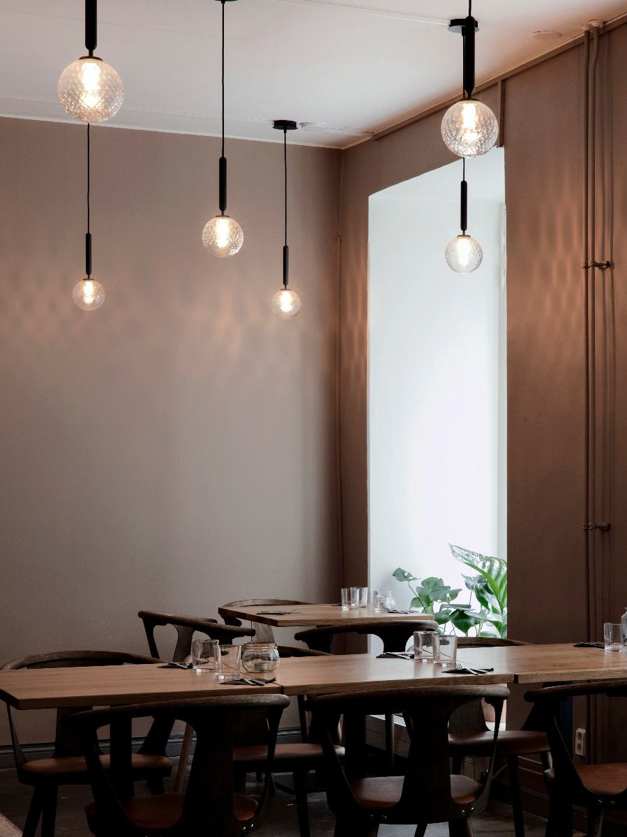 Nuura Lighting Miira Pendant one hanging in a restaurant