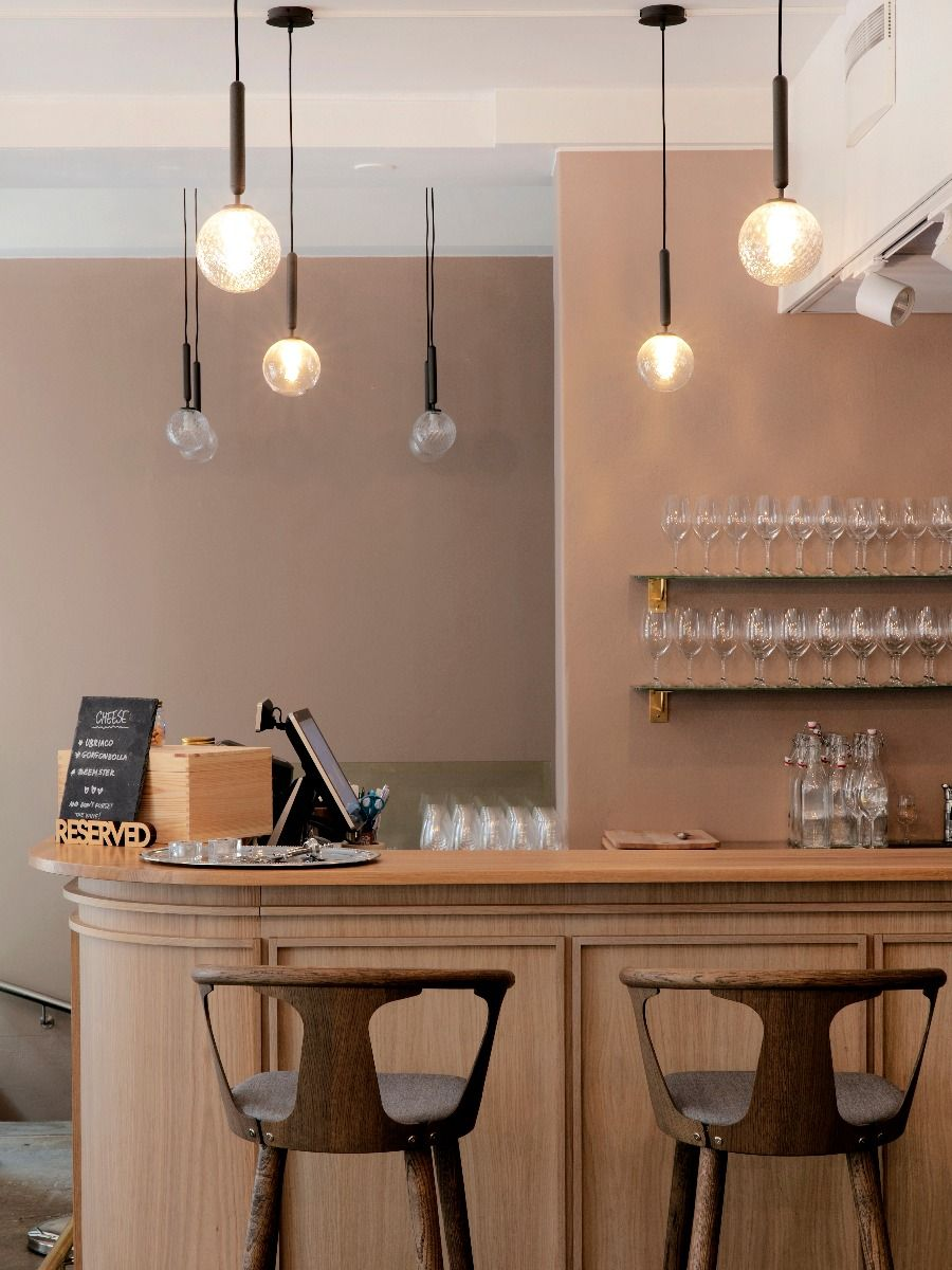 Nuura Lighting Miira Pendant one hanging above a bar in a restaurant