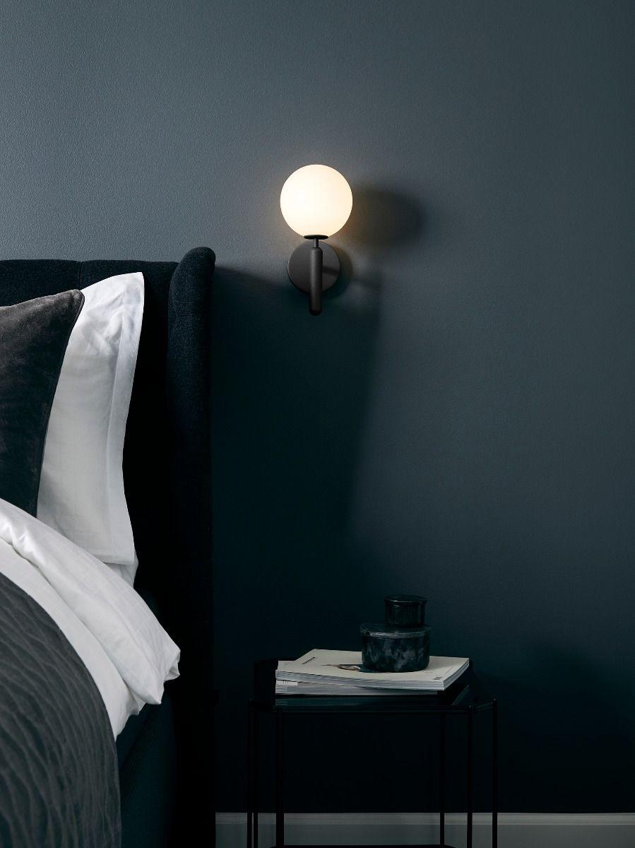 Nuura Miira Wall Light next to a bed
