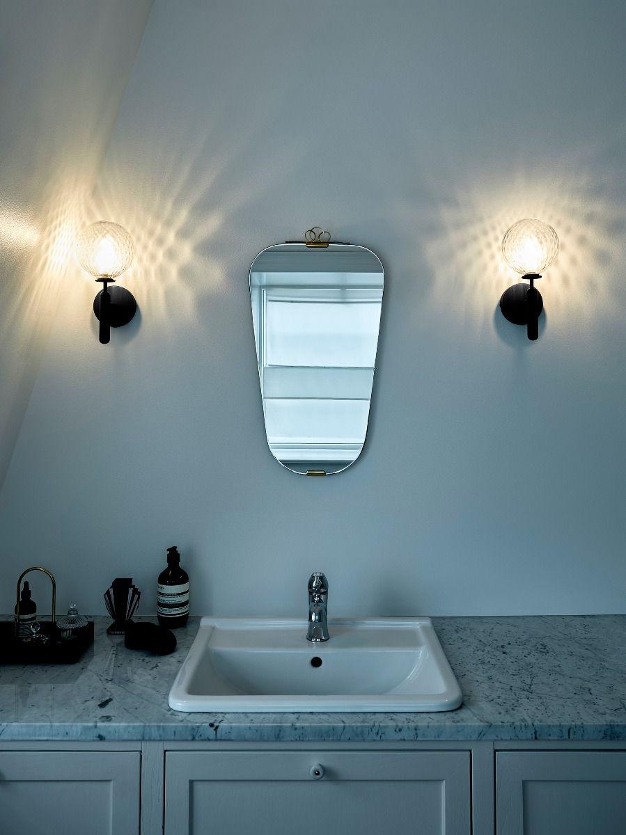 Nuura Miira Wall Light either side of a mirror in bathroom