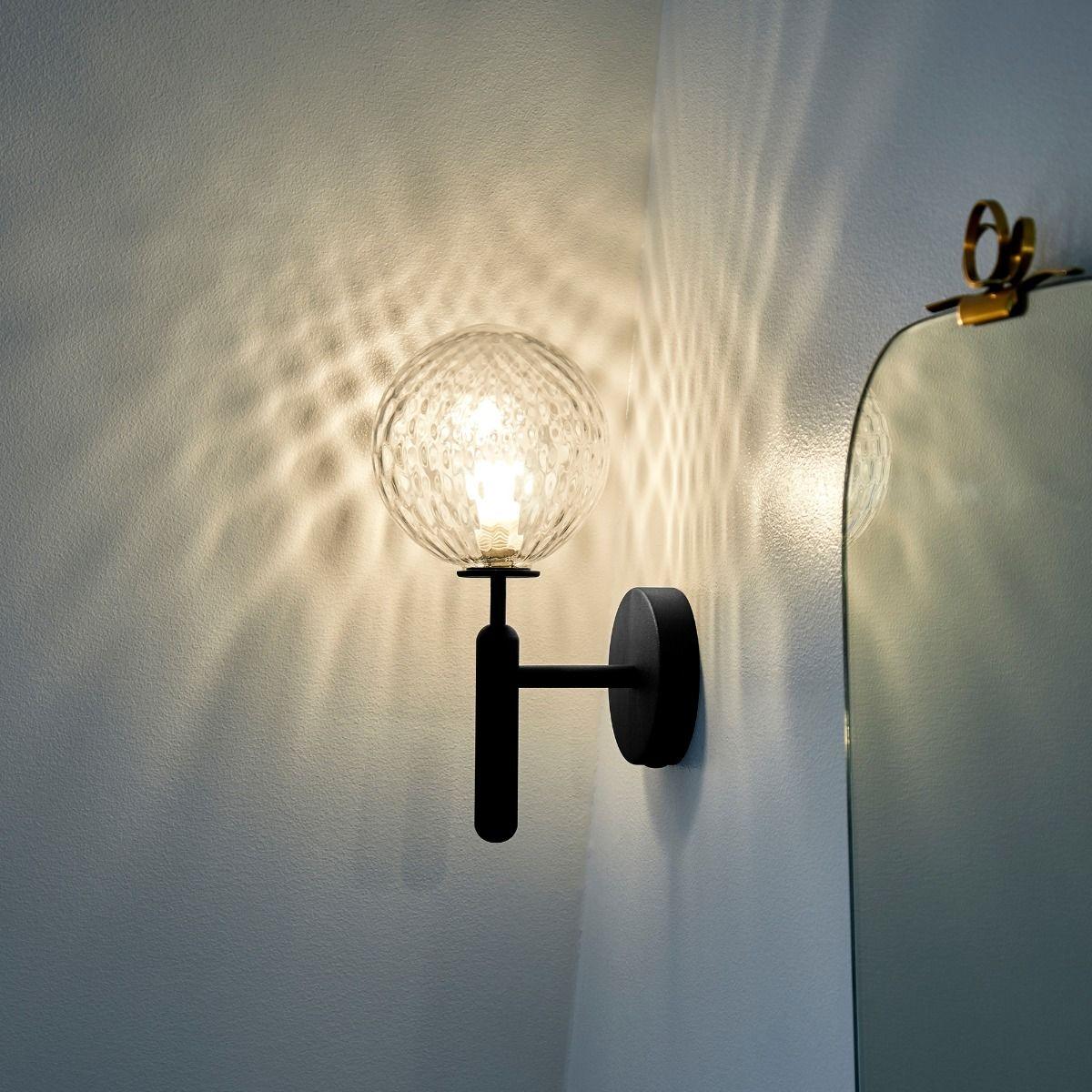 Nuura Miira Wall Light close up next to bathroom mirror