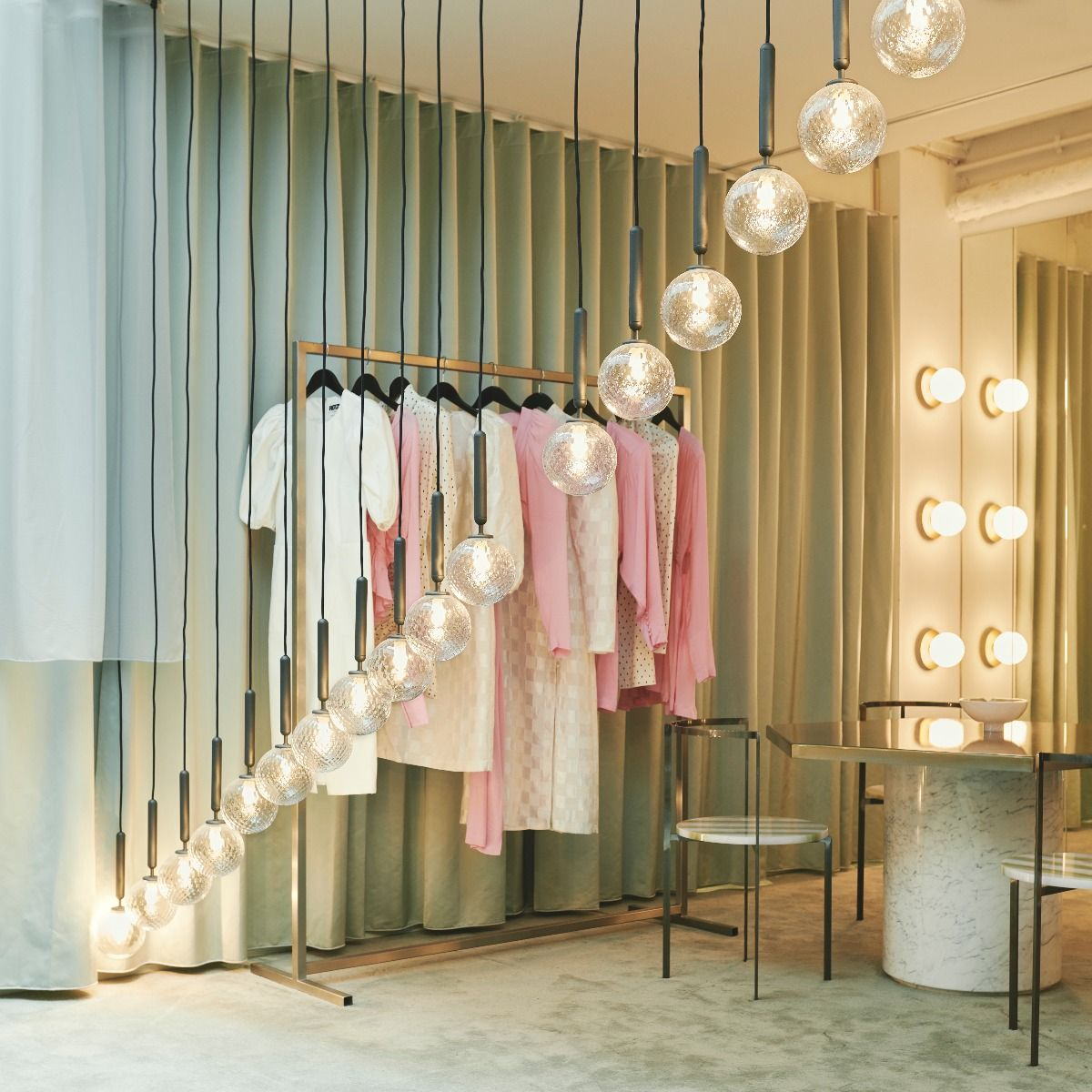 Nuura Lighting Miira Pendant one hanging in a clothes store