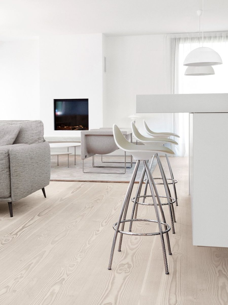 STUA Onda Swivel Bar Stool in stone in a kitchen with light wood floor