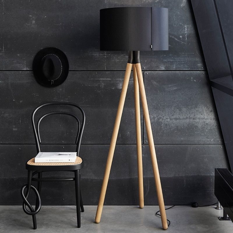 Darø Paso Wood Floor Light on a black wooden panel wall