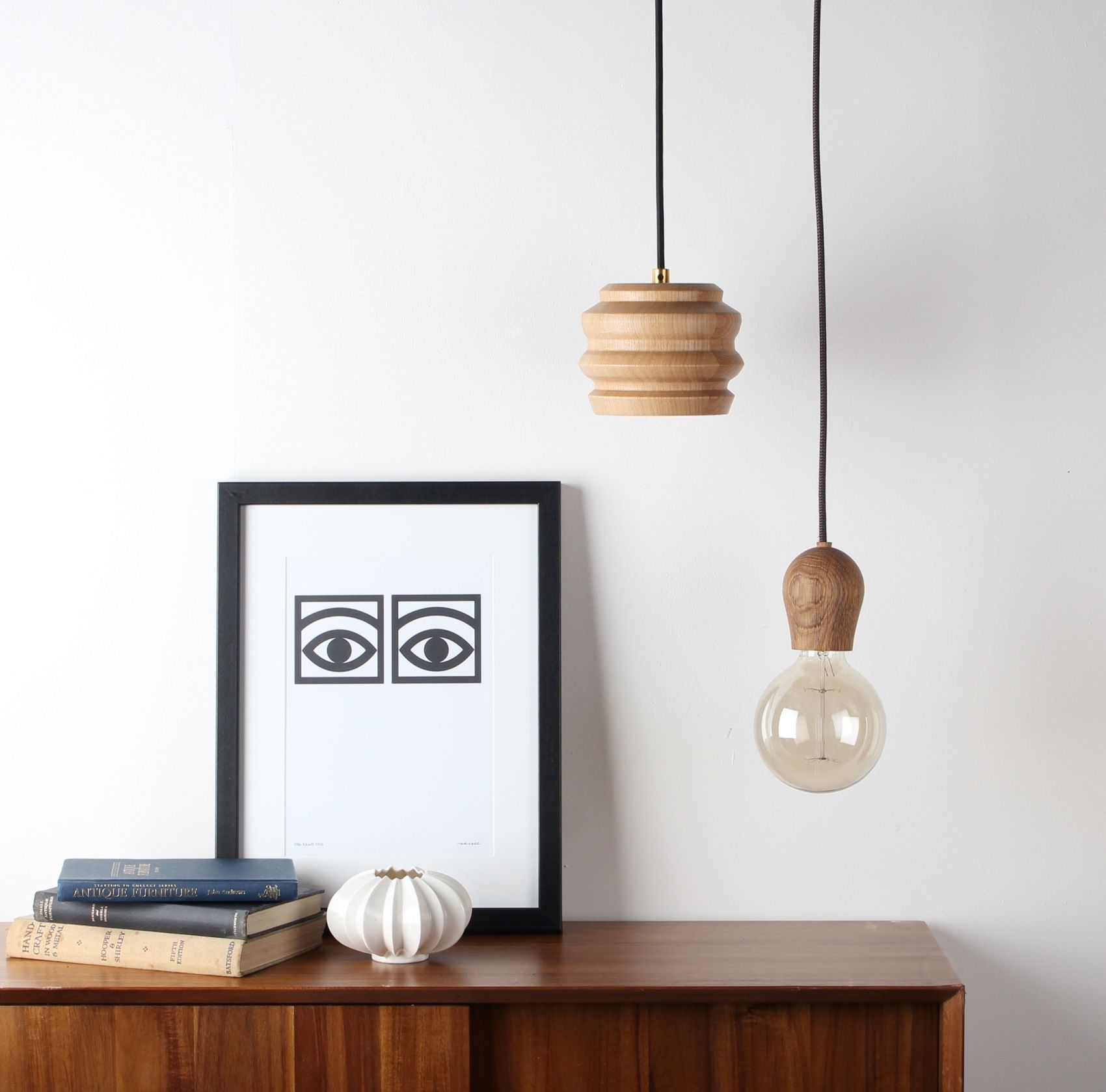 Nordic Tales Bright Sprout Pendant oiled oak hanging above side board next to the cph peak pendant