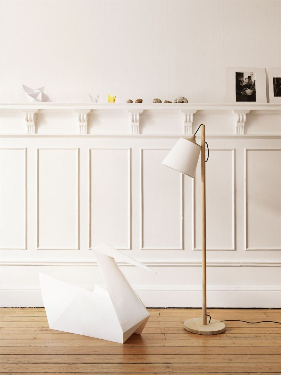 Muuto Pull Floor Lamp in front of whiter panelled wall