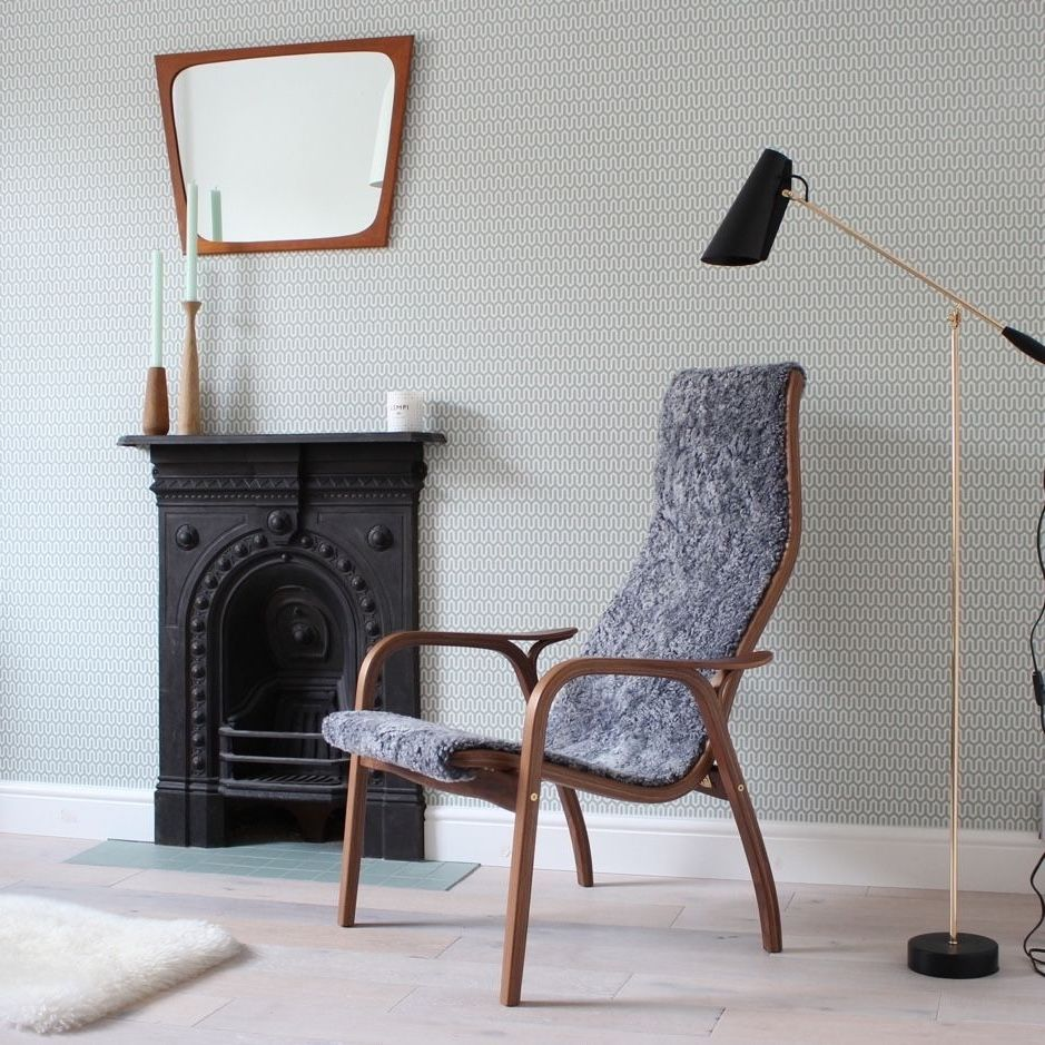 Lamino Easy Chair by fire place in walnut and grey