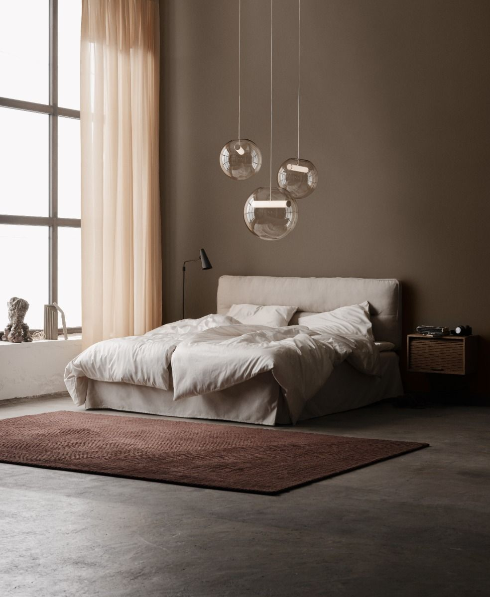 Northern Reveal Pendant in two sizes over a bed